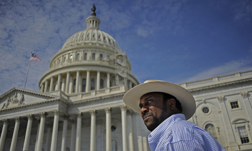President of the Black Farmers Association John Boyd Jr. protests the non payment of Black farmers in a case settled years ago by meeting with lawmakers and driving his tractor to Capitol Hill in Sept. 2010. (Melina Mara/The Washington Post via Getty Images)