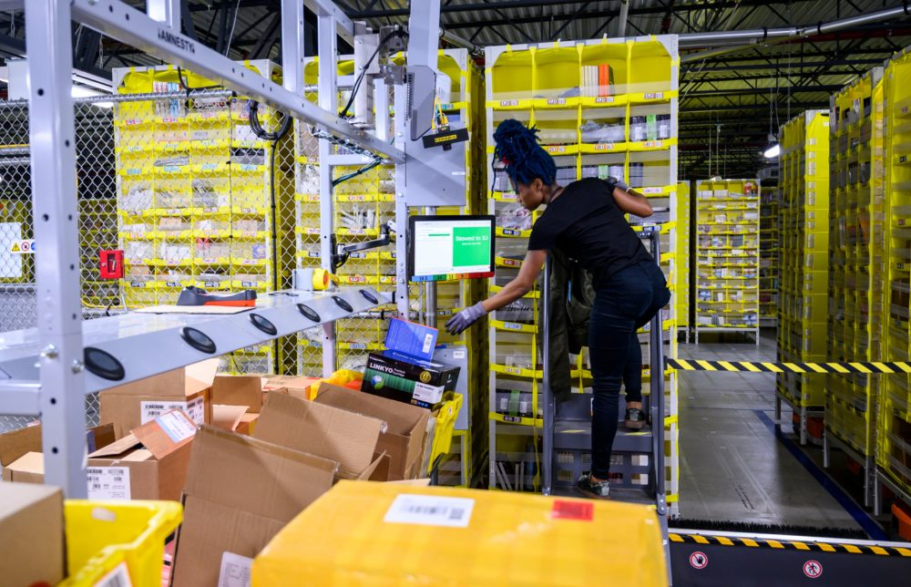 A woman works at a distribution station an Amazon fulfillment center. (Johannes Eisele/AFP via Getty Images)