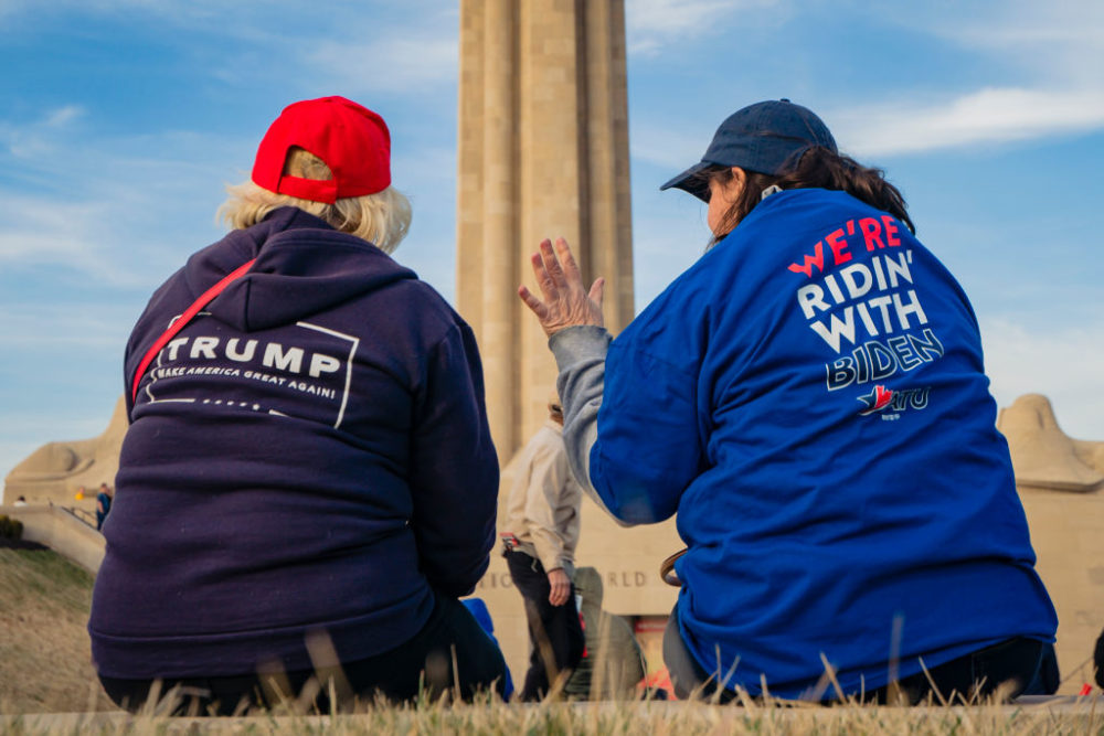 A President Donald Trump and a former Vice President Joe Biden supporter converse before the Joe Biden Campaign Rally at the National World War I Museum and Memorial on March 7, 2020 in Kansas City, Missouri. (Kyle Rivas/Getty Images)