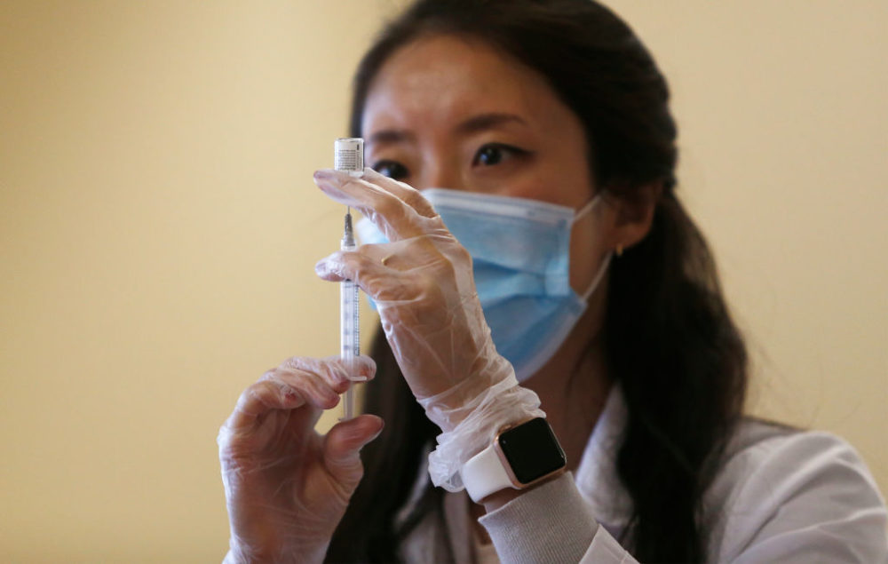 Donna Ko, pharmacist for CVS, prepares the Pfizer-BioNTech COVID-19 vaccine to give to veterans at the Soldier's Home in Chelsea, MA on Dec. 29, 2020. (Jessica Rinaldi/The Boston Globe via Getty Images)