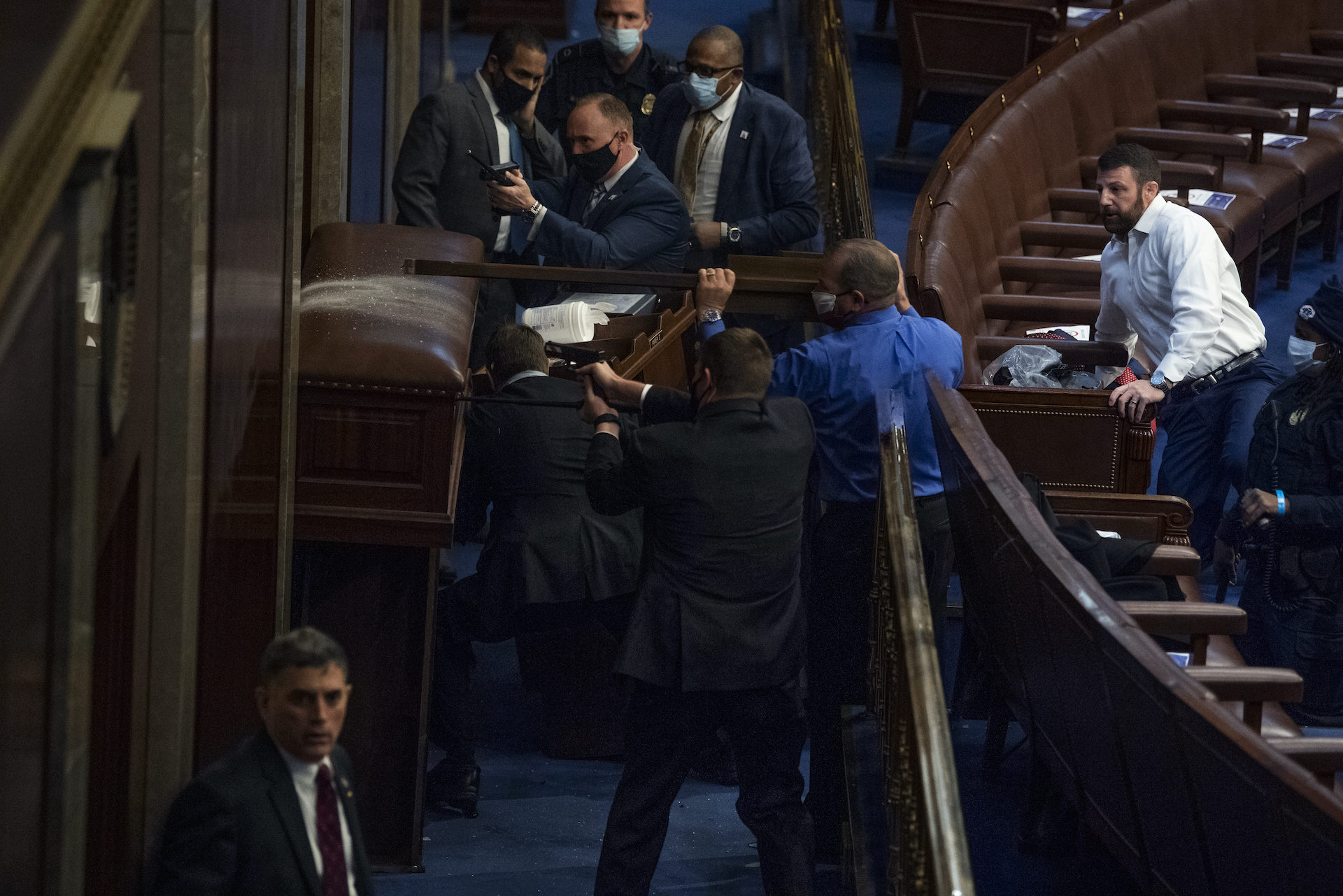 Security barricades the door of the House chamber as protesters try to break in to the joint session of Congress certifying the Electoral College vote on Wednesday. (Tom Williams/CQ-Roll Call, Inc via Getty Images)