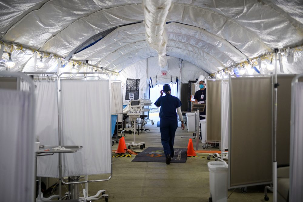 A nurse wears PPE as she attends to patients in a suspected COVID-19 patient triage area set up in a field hospital tent outside of Martin Luther King Jr. Community Hospital on Jan. 6, 2021 in Los Angeles, California. (Patrick T. Fallon/AFP/Getty Images)