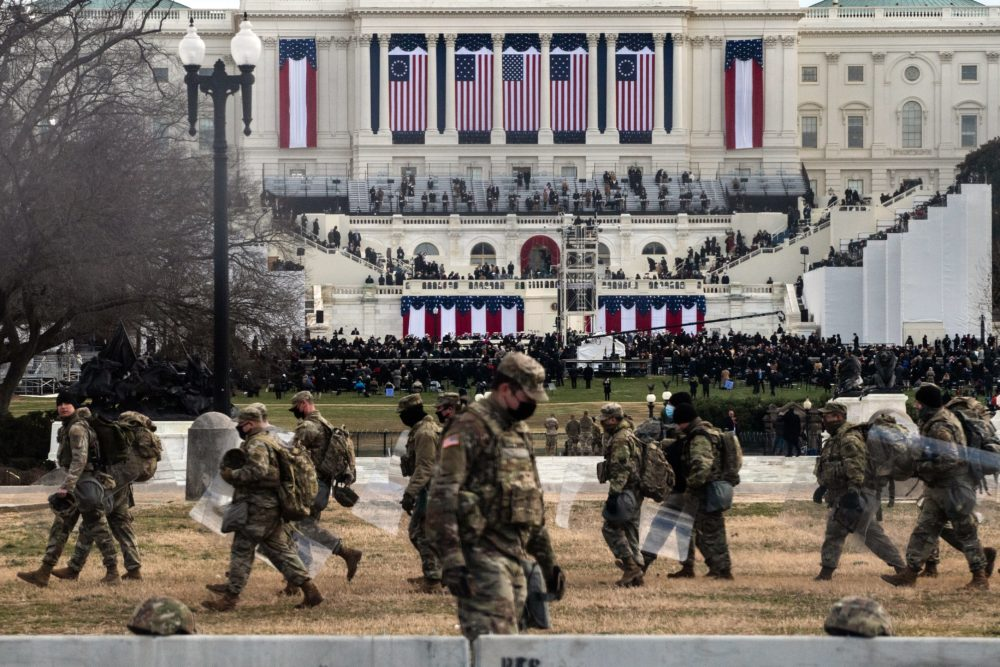 National Guard troops carry riot shields as they assume positions in the vicinity of the U.S. Capitol as the  Inauguration of Joe Biden begins. (Roberto Schmidt/AFP via Getty Images)