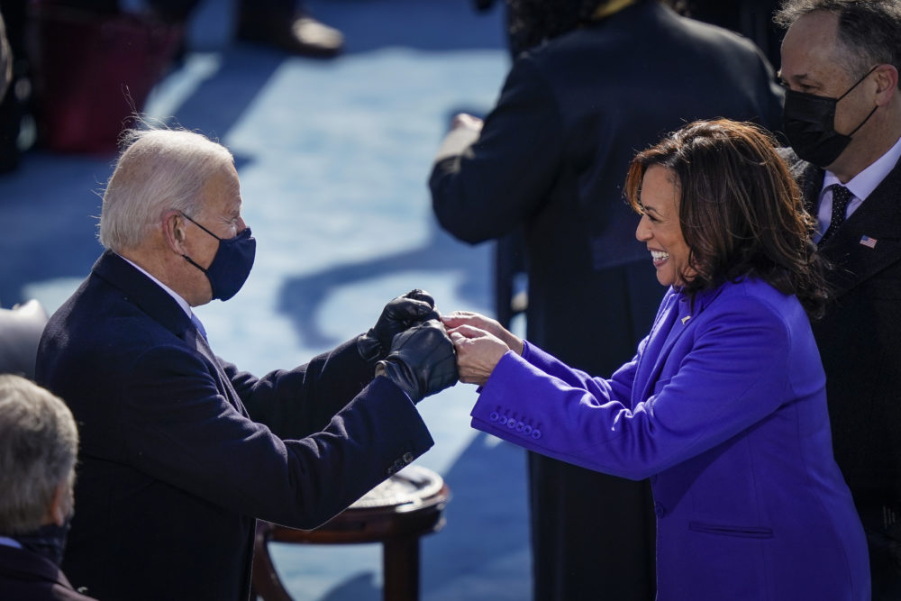 U.S. President-elect Joe Biden fist bumps newly sworn-in Vice President Kamala Harris after she took the oath of office on the West Front of the U.S. Capitol on January 20, 2021 in Washington, DC.  (Drew Angerer/Getty Images)
