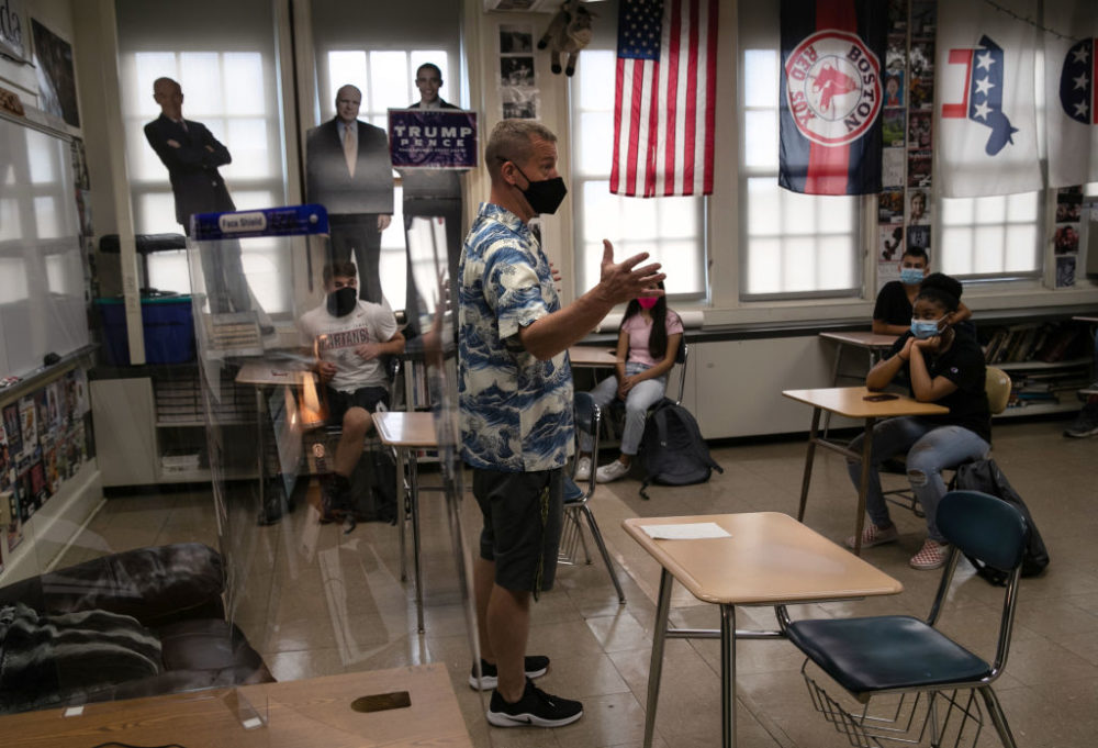 Honors civics teacher Mike Brown discusses the presidential election with masked students on the first day of school at Stamford High School on Sept. 8, 2020 in Stamford, Connecticut. (John Moore/Getty Images)