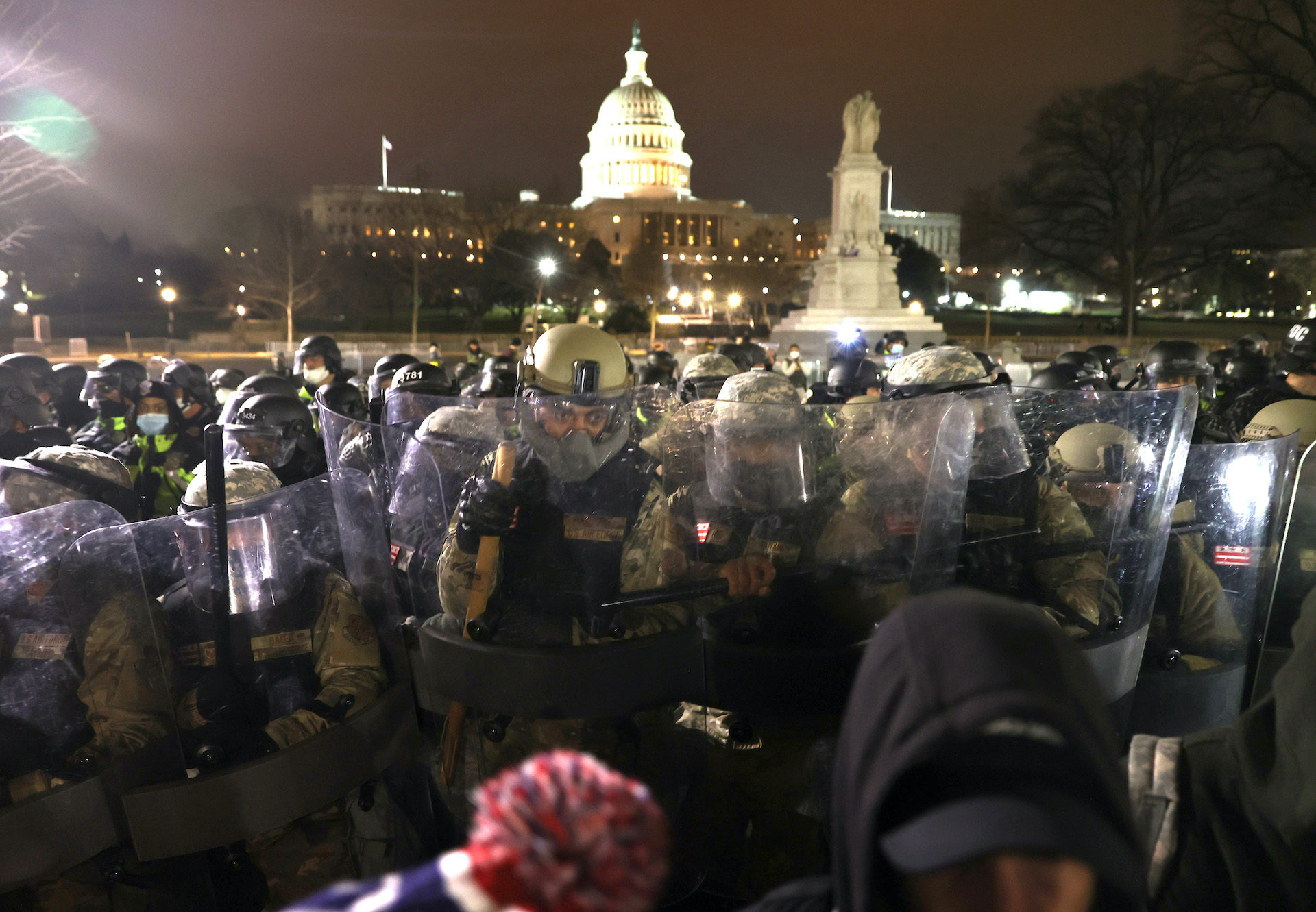 Members of the National Guard assist police officers in dispersing protesters who are gathering at the U.S. Capitol Building.(Tasos Katopodis/Getty Images)