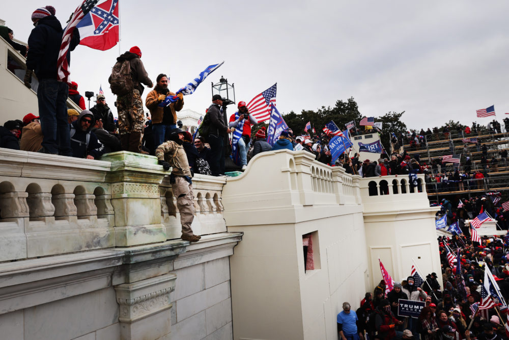 "Thousands of Trump supporters storm the United States Capitol building following a ""Stop the Steal"" rally on Jan. 06, 2021 in Washington, DC. (Spencer Platt/Getty Images)"