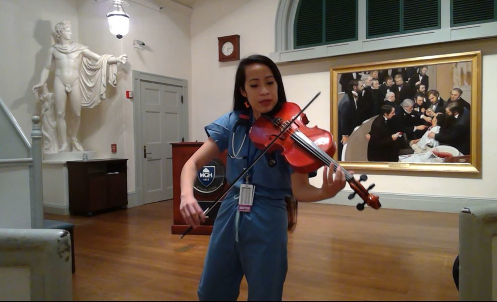 Kathy May Tran studying violin with Luther Warren. (Courtesy)