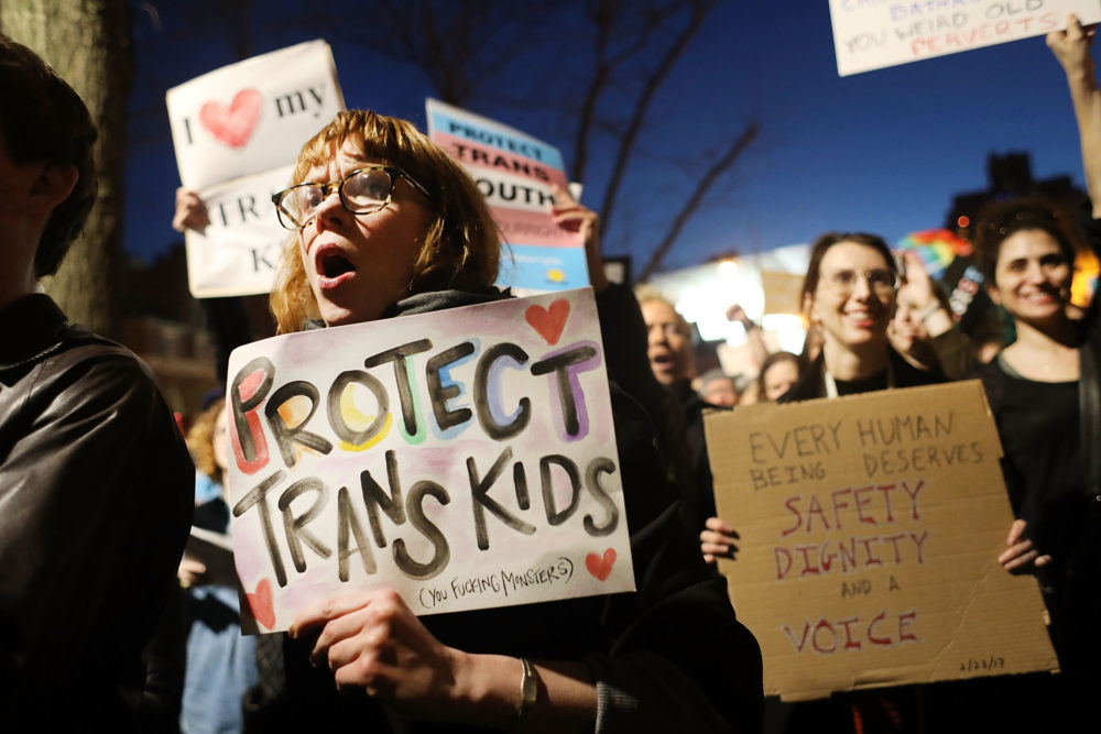 Protests in 2017 against a Trump administration announcement rescinding an Obama-era order allowing transgender students to use school bathrooms matching their gender identities, at the Stonewall Inn in New York City. (Spencer Platt/Getty Images)