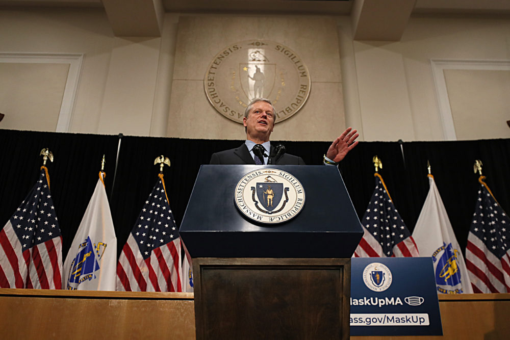 Gov. Charlie Baker addressed the media about his $668 million relief bill for small businesses during the second wave of the COVID-19 pandemic at the State House on Dec. 23, 2020. (Suzanne Kreiter/The Boston Globe via Getty Images)
