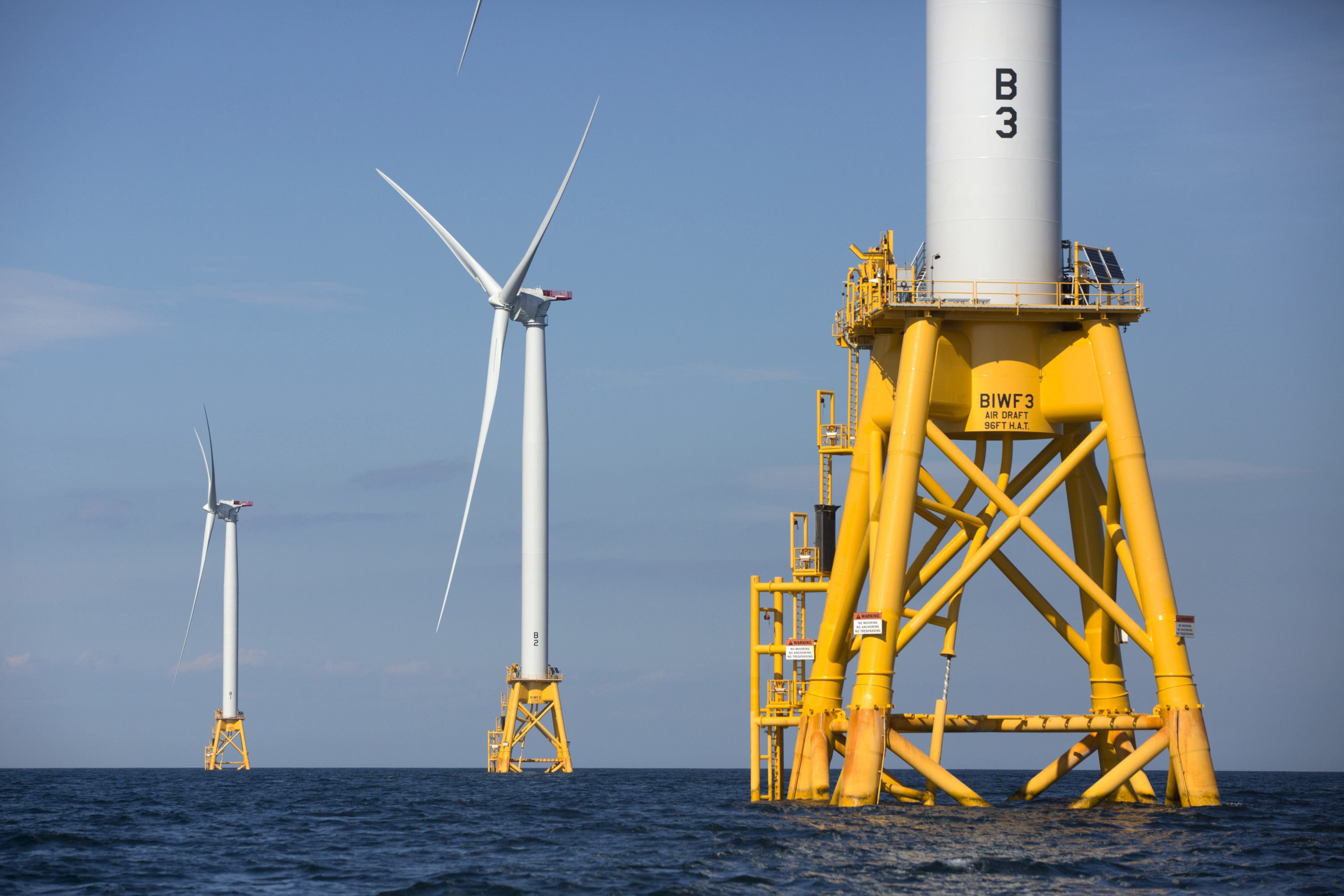 In this 2016 file photo, three of Deepwater Wind's five turbines stand in the water off Block Island, R.I, the nation's first offshore wind farm. (Michael Dwyer/AP)