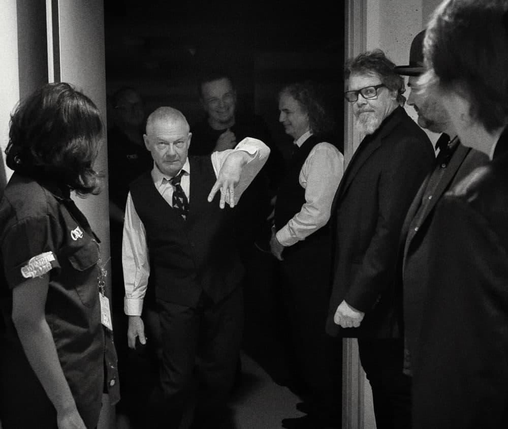 Robert Fripp (center) backstage. (Courtesy Tony Levin)