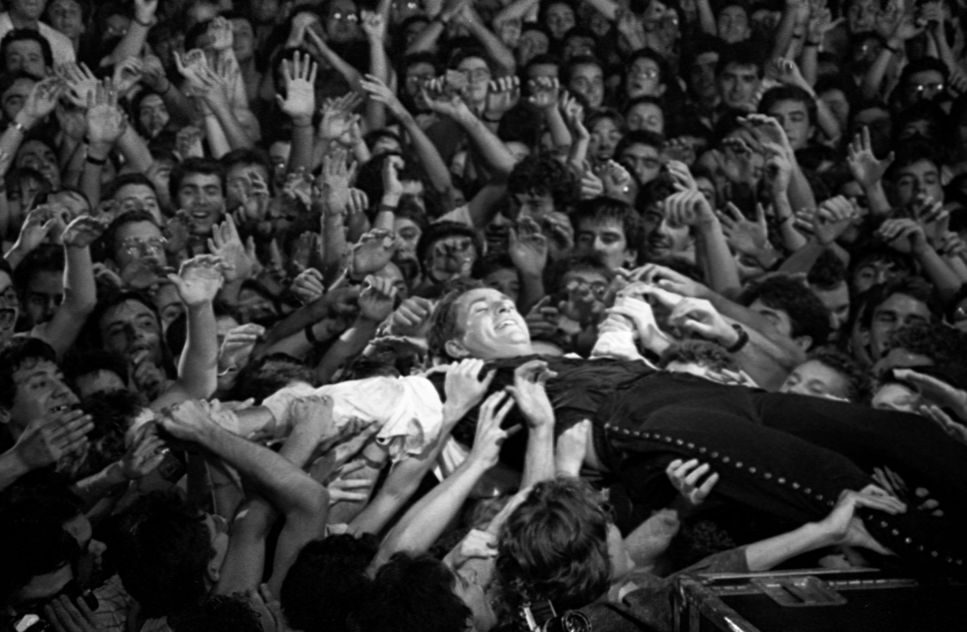 Peter Gabriel backsliding into an audience. (Courtesy Tony Levin)