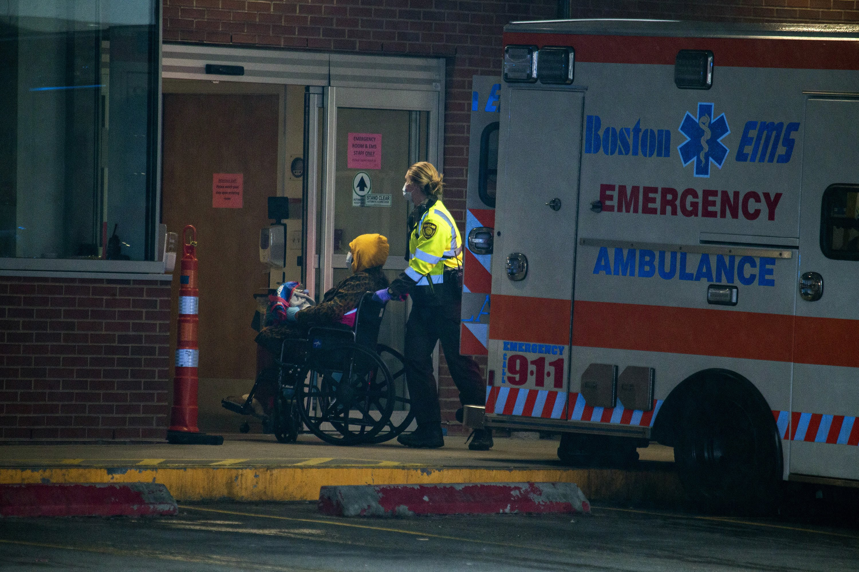 Boston EMS wheels a patient into the emergency entrance at Boston Medical Center. (Jesse Costa/WBUR)