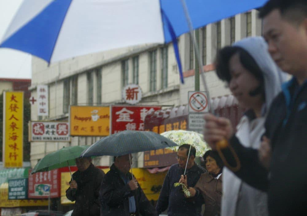 Pedestrians make their way through the Chinatown district in Oakland, California. (Ben Margot/AP)