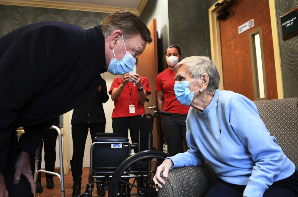 Gov. Ned Lamont greets 95-year-old Jeanne Peters, a rehab patient at a nursing facility. She was given the first COVID-19 vaccination at the nursing home on Dec. 18, 2020, in West Hartford, Conn. (Stephen Dunn/AP/Pool)