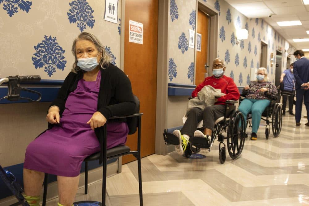 Nursing home residents form a line for the COVID-19 vaccine at Harlem Center for Nursing and Rehabilitation, a nursing home facility. (Yuki Iwamura/AP)