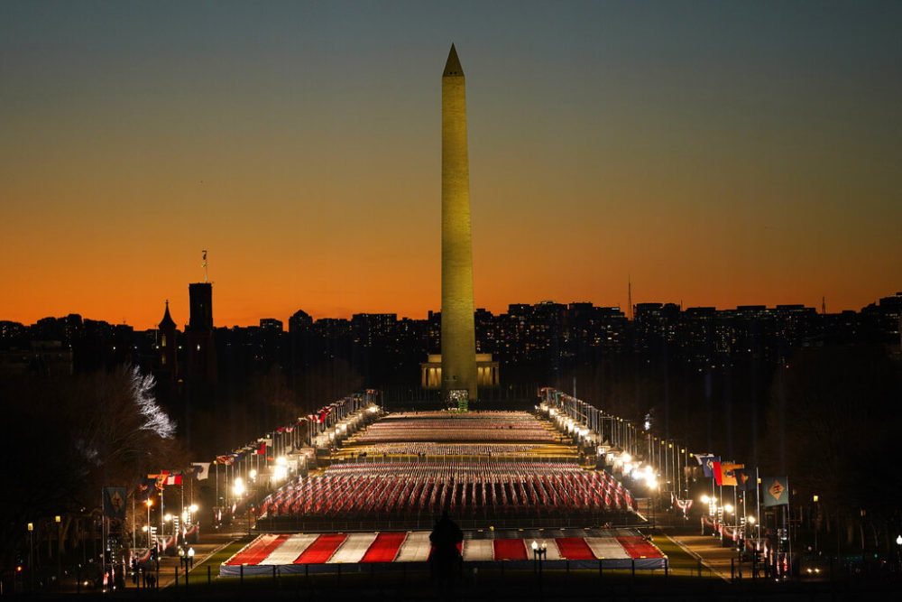 A field of flags is spread across the National Mall, with the Washington Monument in the background ahead of the 59th Presidential Inauguration in Washington. (AP Photo/Susan Walsh)