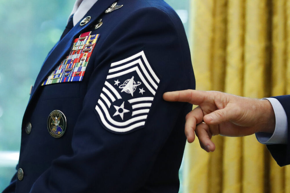 Chief Master Sgt. Roger Towberman displays his insignia during a presentation of the United States Space Force flag in the Oval Office of the White House in Washington. (Alex Brandon/AP)