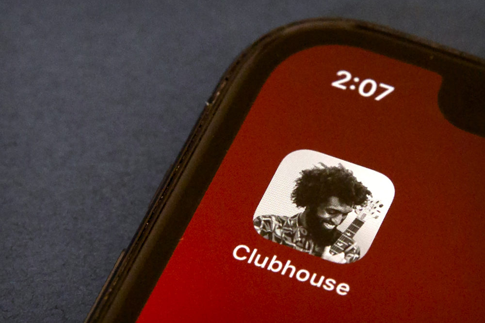 The icon for the social media app Clubhouse is seen on a smartphone screen. (Mark Schiefelbein/AP)