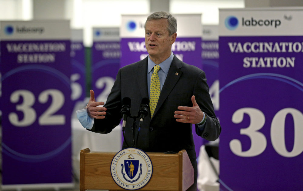 Gov. Charlie Baker speaking at a mass vaccination site at the Natick Mall on Feb. 24. (Matt Stone/The Boston Herald via AP, Pool)
