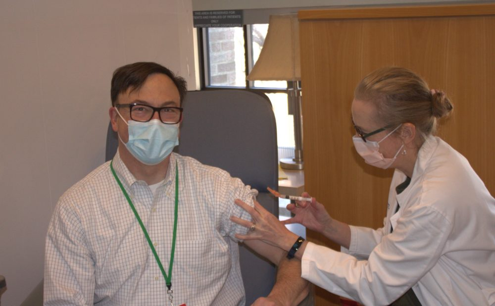 CEO Alexa B. Kimball M.D. administers the COVID-19 vaccine to Dr. Christopher Awtrey, Vice President for Network Operations and Provider Experience at Harvard Medical Faculty Physicians at Beth Israel Deaconess Medical Center in Boston. (Courtesy)