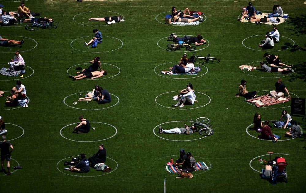 People are seen social distancing in Brooklyn. (Johannes Eisele/AFP via Getty Images)