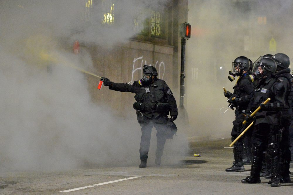 Police shoot pepper spray toward a protester during a demonstration over the death of George Floyd in Boston, Massachusetts, on May 31, 2020. (Joseph Prezioso/AFP via Getty Images)