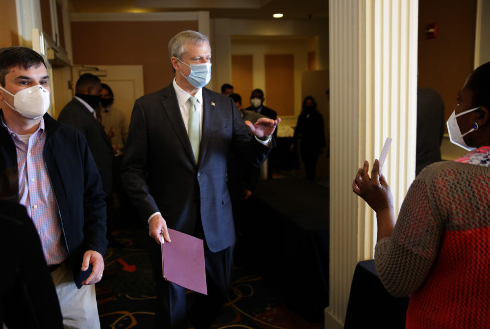 Gov. Charlie Baker tours the mass vaccination site at the DoubleTree by Hilton Hotel Boston North Shore in Danvers, MA  on Feb. 10, 2021. (Photo by Jonathan Wiggs/The Boston Globe via Getty Images)