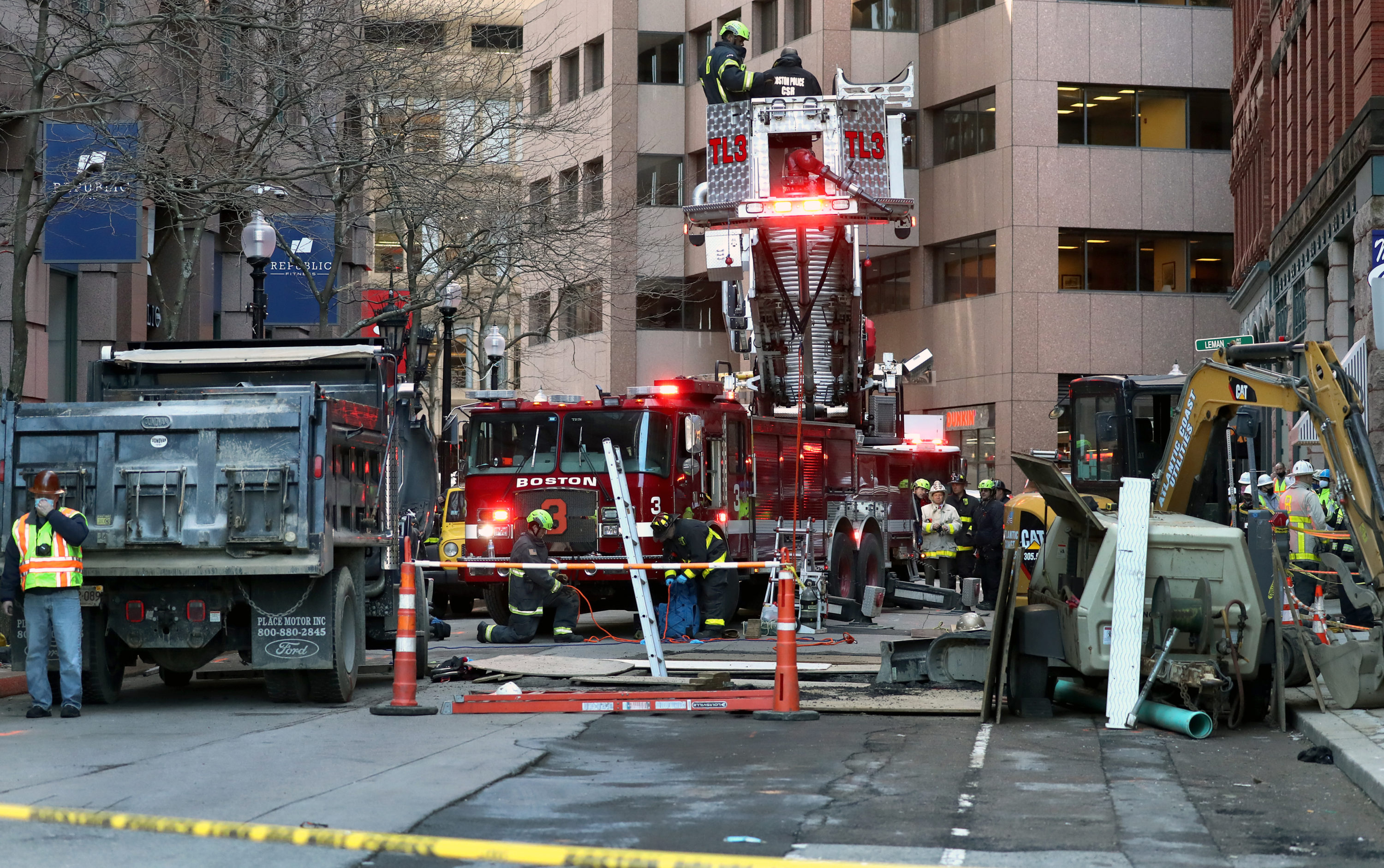 The truck involved in the crash is pictured on the left as firefighters and first responders stand at the scene in downtown Boston on Feb. 24, 2021. (David L. Ryan/The Boston Globe via Getty Images)