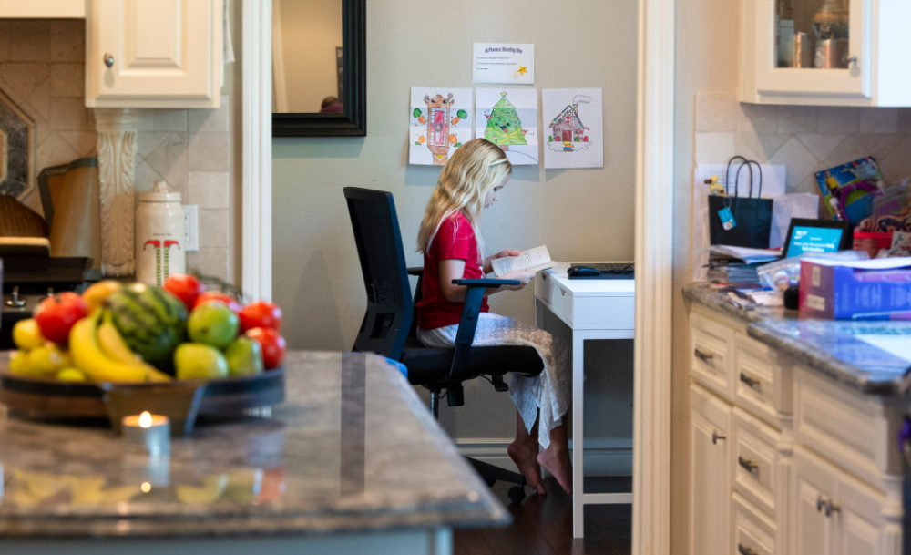 A student studies at a makeshift desk during at-home learning in Orange, CA on Wednesday, December 9, 2020. (Paul Bersebach/MediaNews Group/Orange County Register via Getty Images)