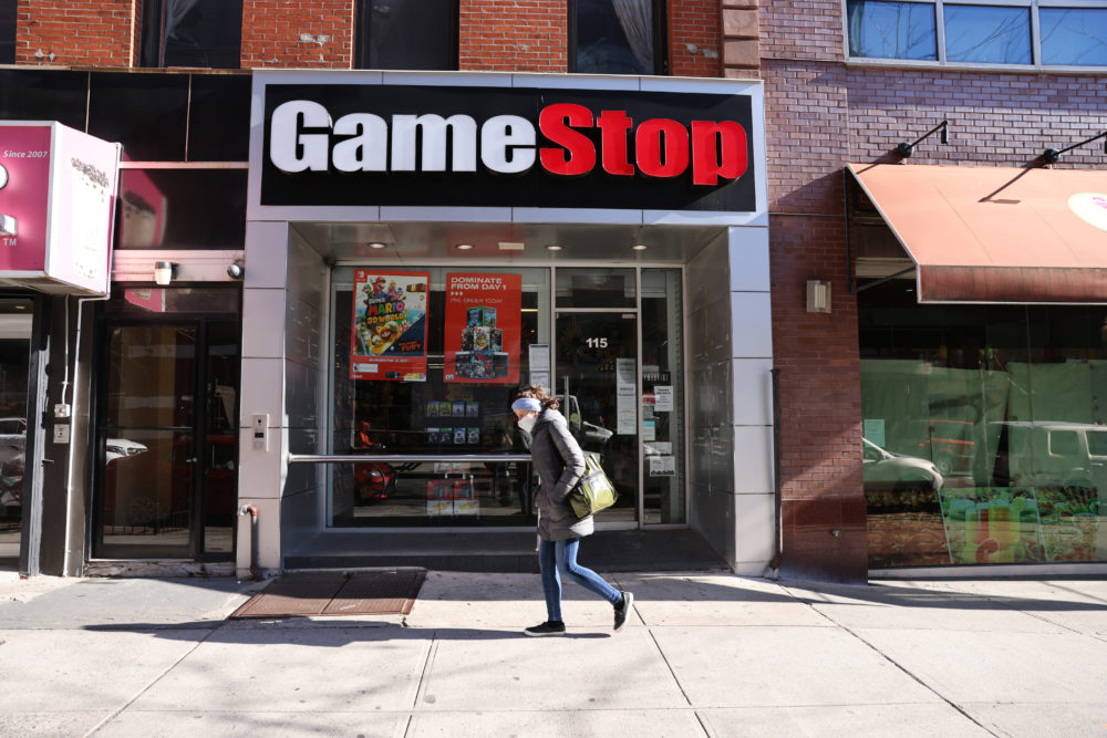 People walk by a GameStop store in Brooklyn on January 28, 2021 in New York City. Markets continue a volatile streak with the Dow Jones Industrial Average rising over 500 points in morning trading following yesterdays losses. Shares of the video game retailer GameStop plunged. (Spencer Platt/Getty Images)