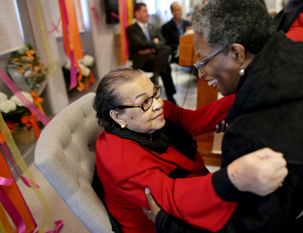 Doris Bunte, left, is congratulated by longtime friend Deborah McBrayer during a ceremony in 2018. Bunte died on Tuesday.(Jonathan Wiggs/The Boston Globe via Getty Images)