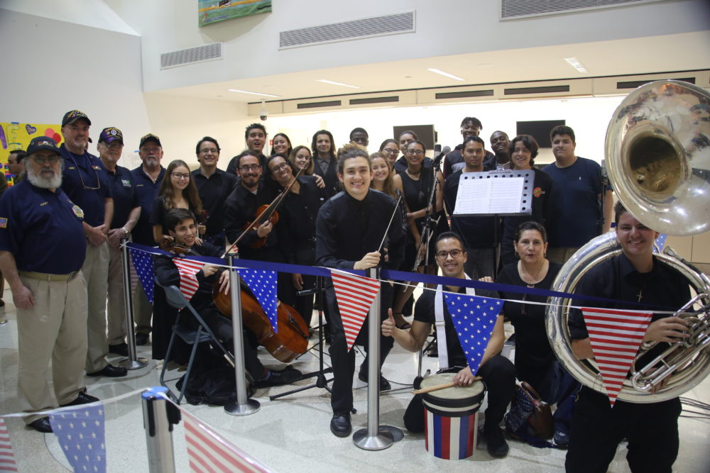 Members of Voices of Freedom playing for WWII, Korea and Vietnam veterans at an Honor Flight South Florida Homecoming Celebration in Miami International Airport. (Courtesy)