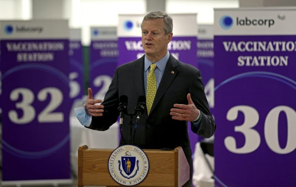 Massachusetts Gov. Charlie Baker speaks at a mega vaccination site for coronavirus at the Natick Mall on Feb. 24. (Matt Stone/The Boston Herald, pool via AP)