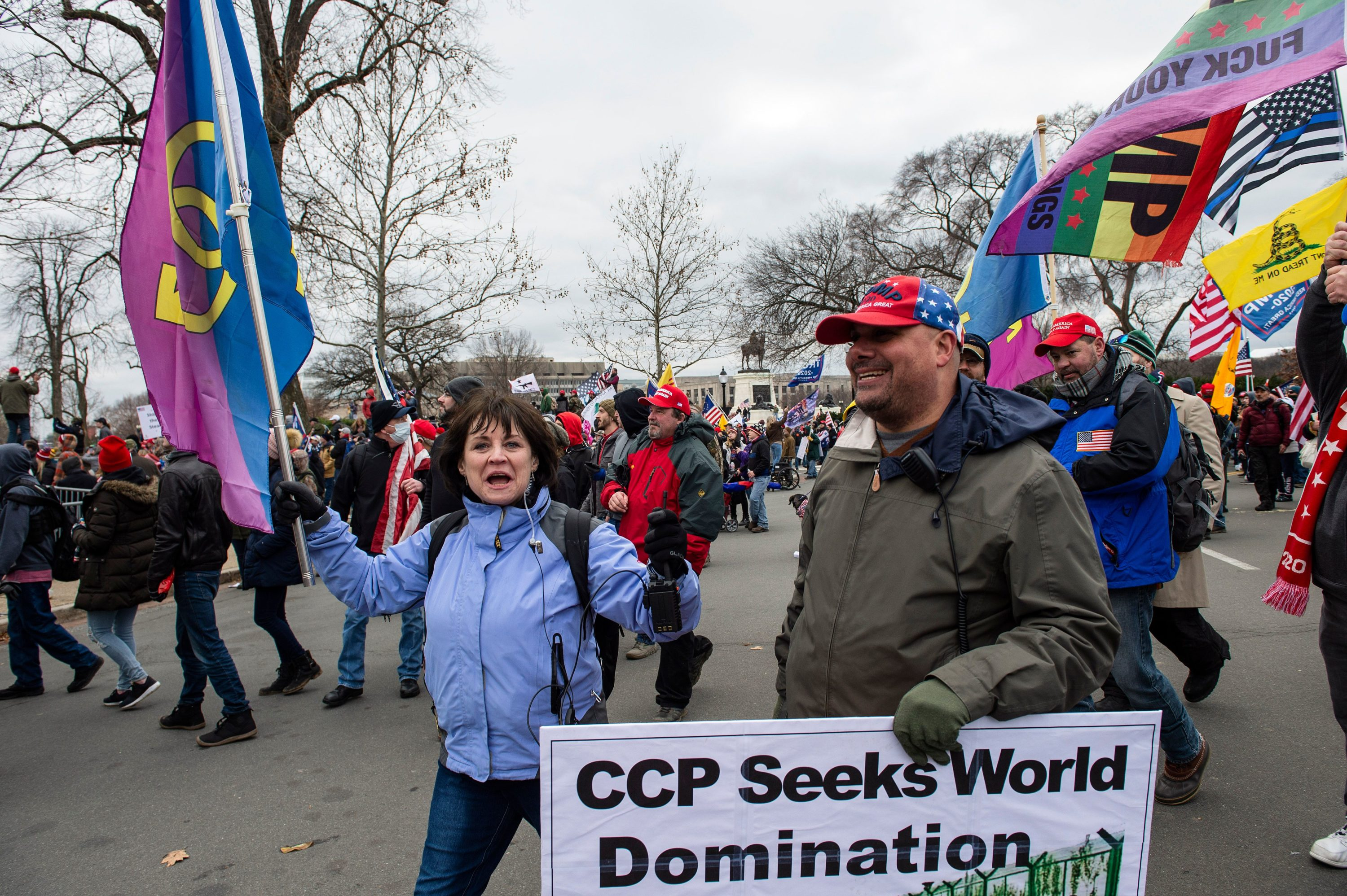 Natick Town Meeting member Suzanne Ianni and Mark Sahady march through the streets of Washington, D.C., before they allegedly stormed the Capitol building on Jan. 6. (Joseph Prezioso/AFP via Getty Images)