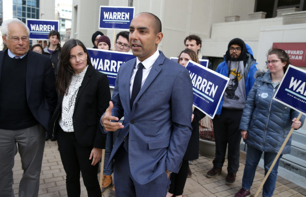 From left, Don Berwick, Dr. Kathryn Stephenson, and state Rep. Jon Santiago show support for presidential candidate Elizabeth Warren in 2020. (Jonathan Wiggs/The Boston Globe via Getty Images)