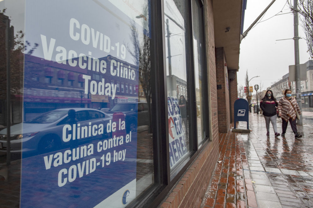Signs in multiple languages let the public know they can get inoculated here at La Colaborativa in Chelsea, Massachusetts on Feb. 16, 2021. (Joseph Prezioso/AFP via Getty Images)