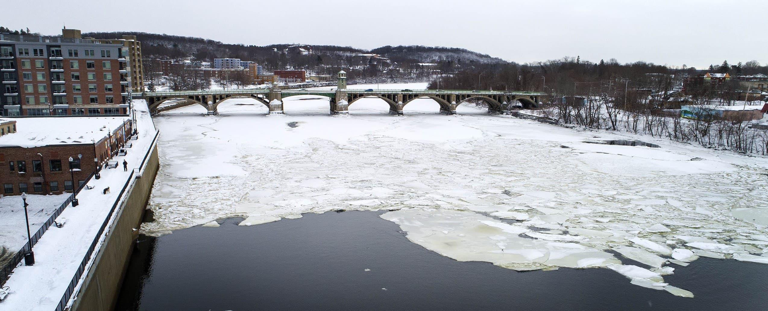 The Merrimack River covered in ice as it passes under Basiliere Bridge in Haverhill. (Robin Lubbock/WBUR)