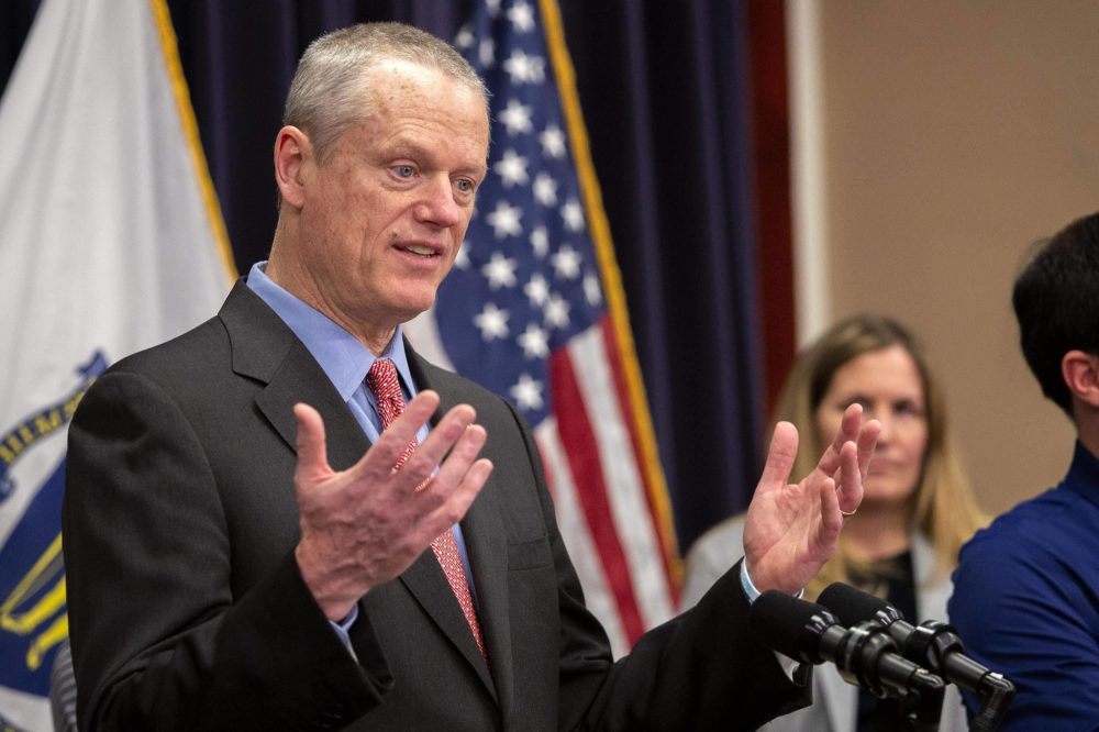 Gov. Charlie Baker talks with reporters at a press conference in the State House in March 2020. (Robin Lubbock/WBUR)