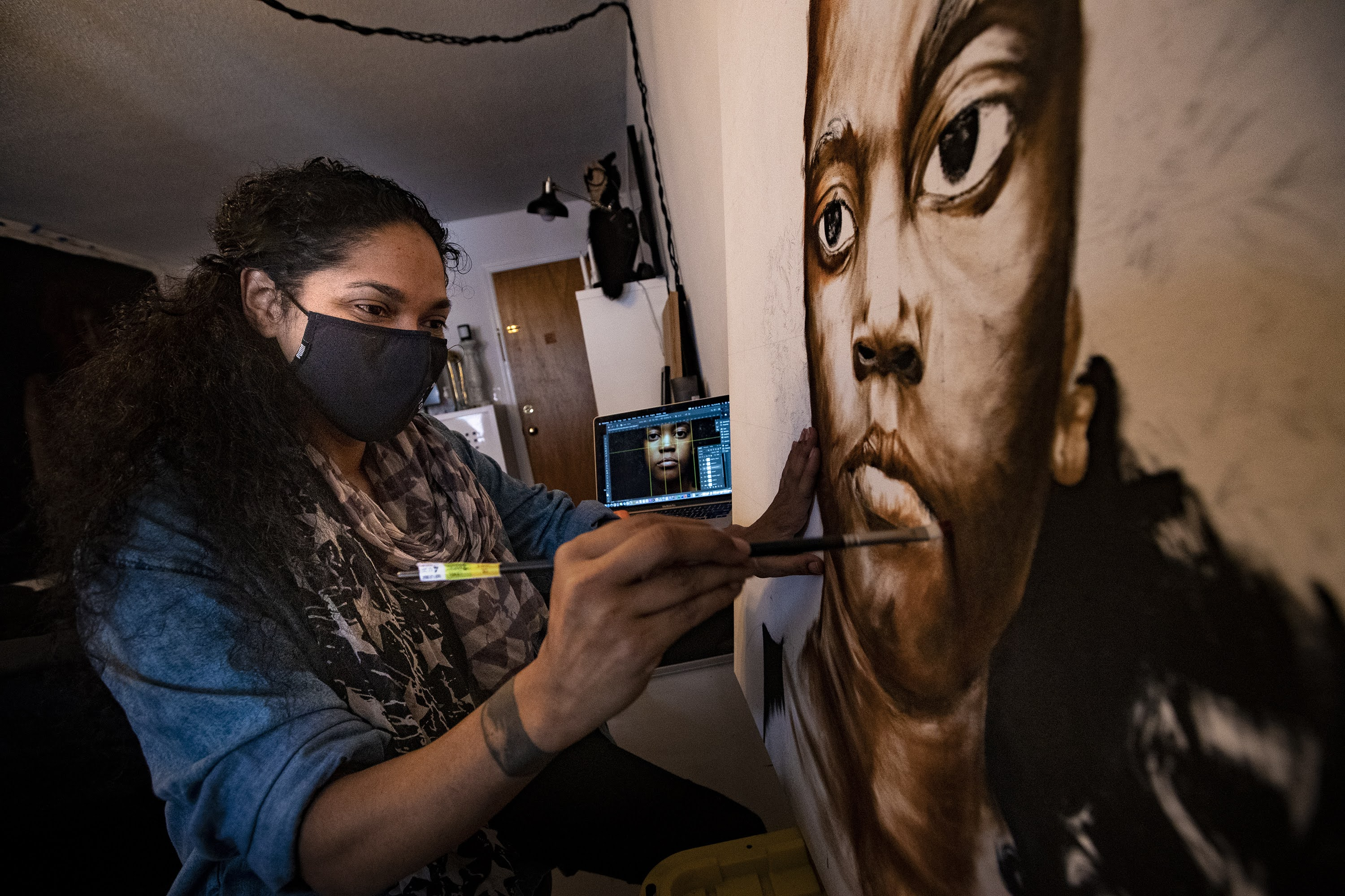 Artist Marla McLeod works on a piece featuring her niece at her studio in New Haven. (Jesse Costa/WBUR)