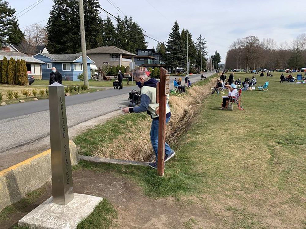 Crossing the border into Peace Arch State Park from Canada, at left, entails stepping across a ditch. (Tom Banse/Northwest News Network)