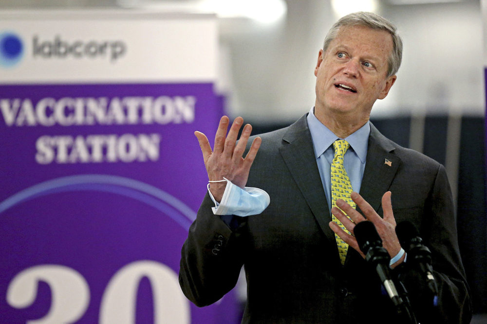 Massachusetts Gov. Charlie Baker speaks at a vaccination site at the Natick Mall on Feb. 24. A year of battling the spread of the coronavirus has taken a political toll on Baker as he faces slumping popularity. (Matt Stone/Boston Herald via AP, Pool, File)