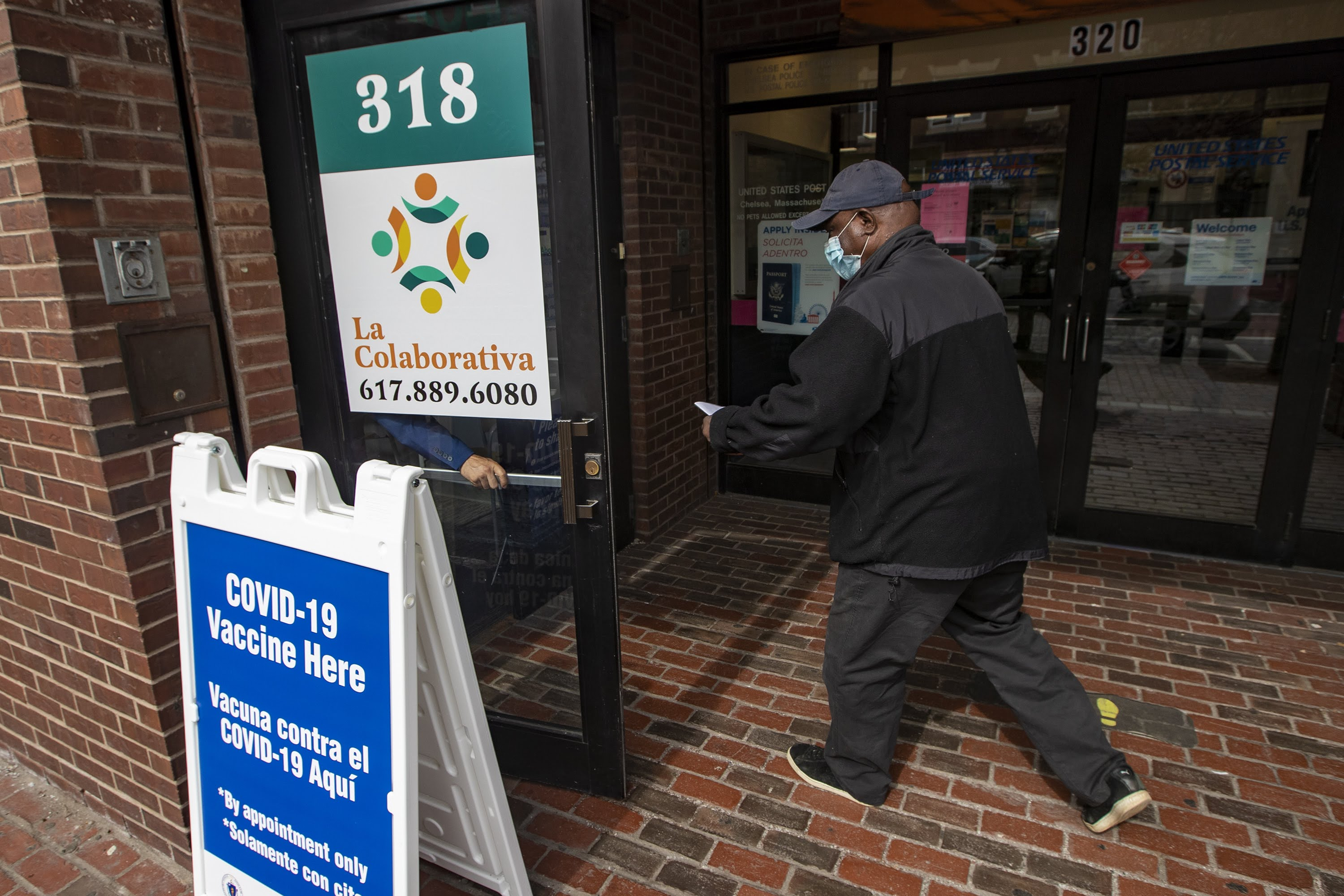 A man enters the La Colaborativa offices on Broadway which is serving as the Chelsea public COVID-19 vaccination site. (Jesse Costa/WBUR)