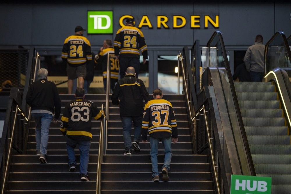 Bruins fans entered TD Garden before a game on March 25. With capacity restricted, ticket prices are soaring. (Jesse Costa/WBUR)