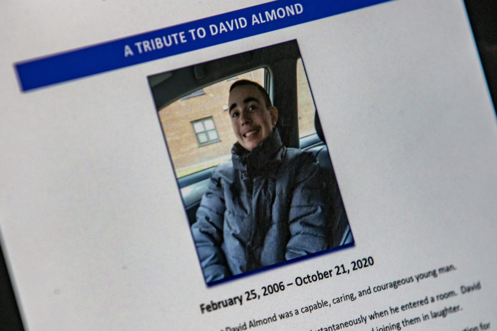 A photo of an image of David Almond contained in the Office of the Child Advocate's report on his death. (Jesse Costa/WBUR)