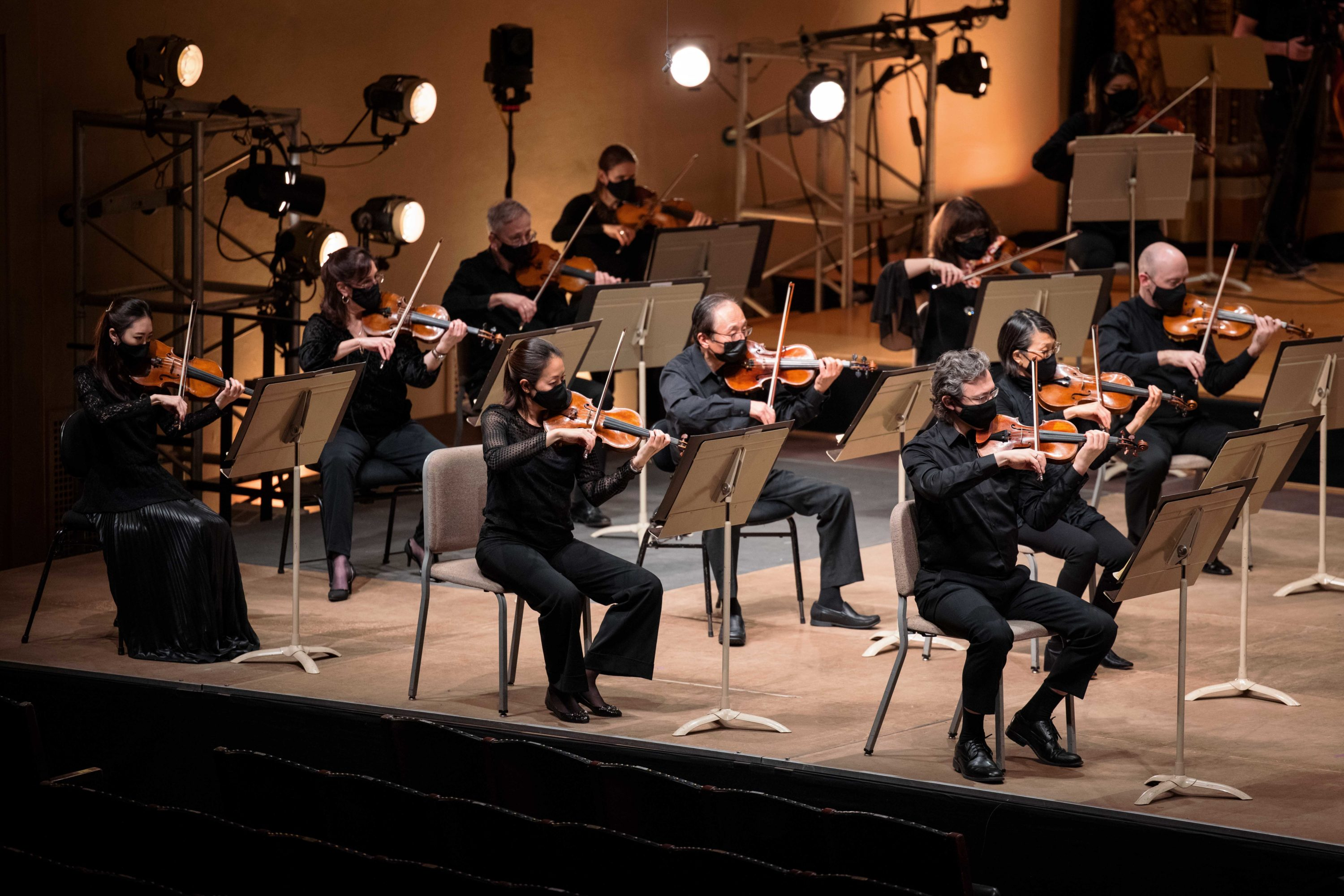 The BSO's violin section during a video shoot directed by Habib Azar. (Courtesy BSO/Aram Boghosian)