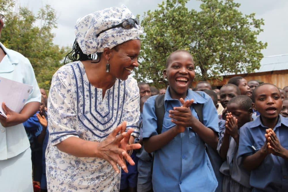 Tererai Trent is seen with school children at Matau Primary School in Hurungwe, near Harare, Zimbabwe, on Jan. 3, 2012. (Tsvangirayi Mukwazhi)