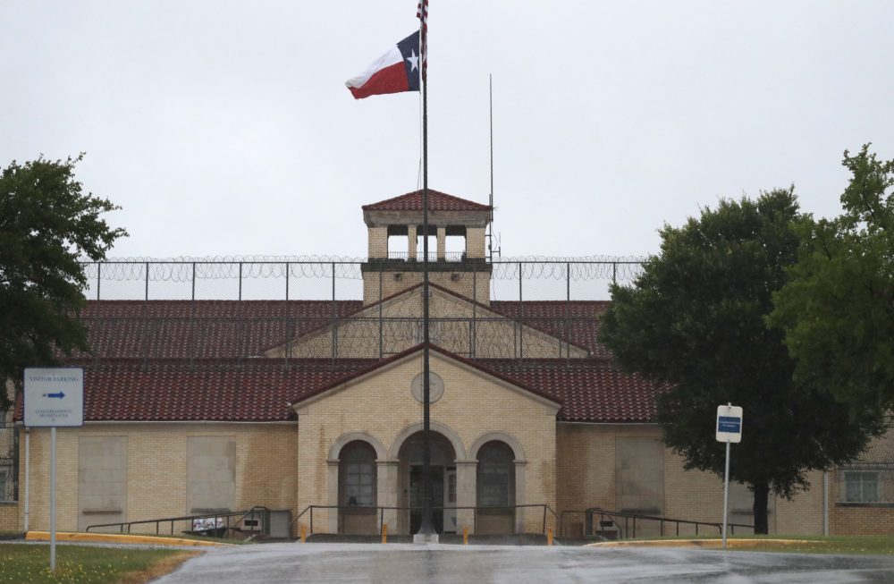 A Texas flag flies in front of the Federal Medical Center prison in Fort Worth, Texas, on May 16, 2020. (LM Otero/AP)