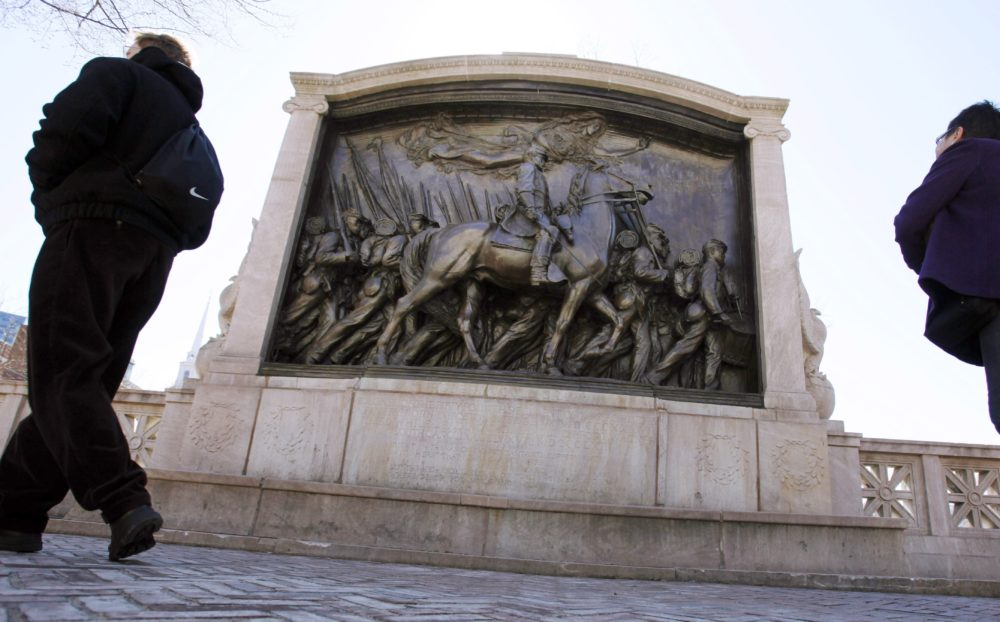 In this March 26, 2011, file photo, people walk past the memorial to Union Col. Robert Gould Shaw and the 54th Massachusetts Volunteer Infantry Regiment, near the State House in Boston. (Michael Dwyer/AP File)